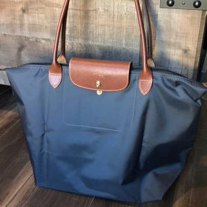 Longchamp Le Pliage. Price is Firm